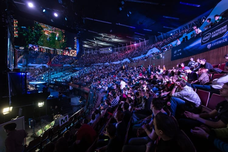 Crowd of esports fan watching professional gamers compete