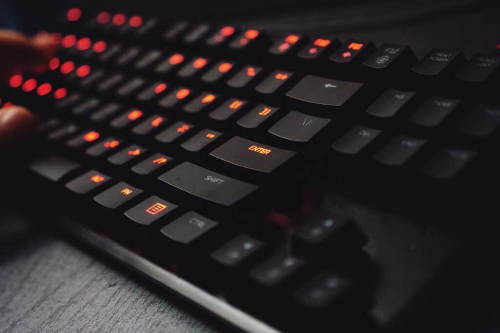 Keyboard closeup with glowing red lights