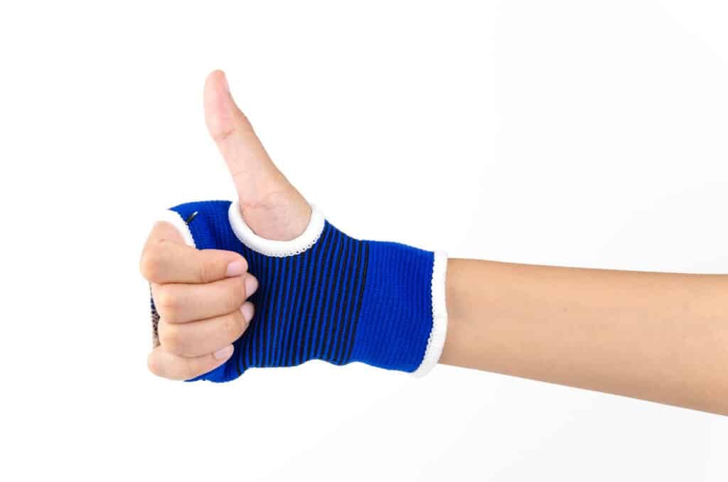 Wrist brace for gaming on hand giving thumbs up
