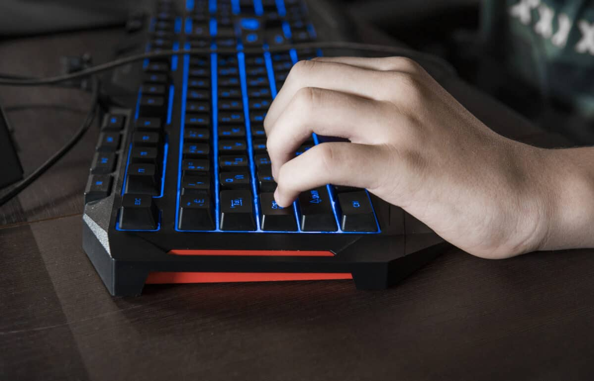 Gamer keyboard with colorful blue lights, modern gamer computer. Blue backlight, backlit on laptop or keyborad computer of gaming